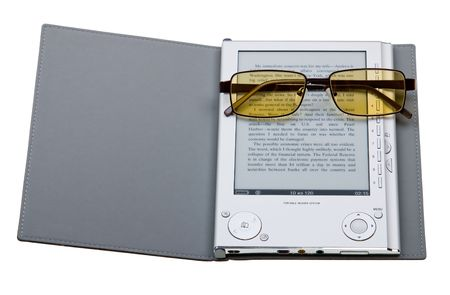 E-book with glasses isolated on white background