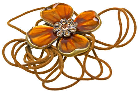 Vintage brown pendant, coulomb flower isolated on white background photo