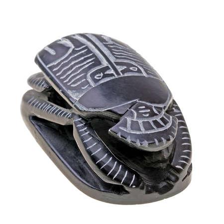 Ritual egyptian scarab isolated on white background photo
