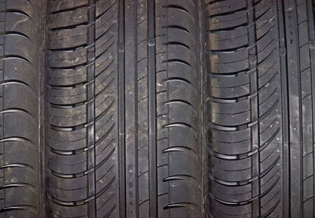 Close-up of car tire to background photo