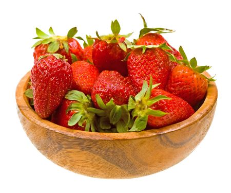 Fresh strawberries on a wooden platter isolated on white background photo