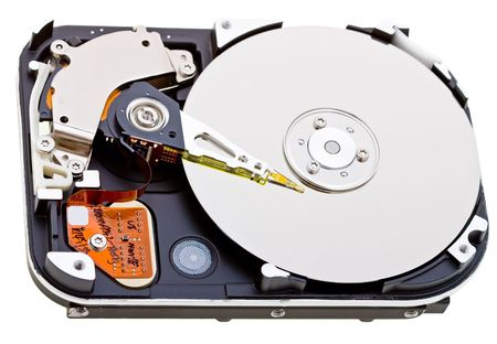 Close-up inside view of  hard disk isolated on white background Stock Photo - 5110146