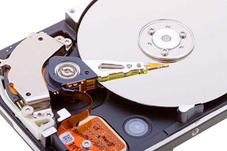 Close-up inside view of hard disk isolated on white background photo