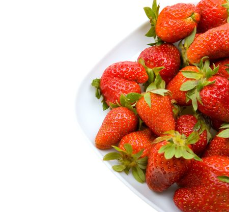 Fresh strawberries on a platter isolated on white background