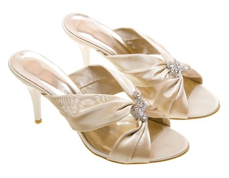 Gold women shoes isolated on white background Stock Photo