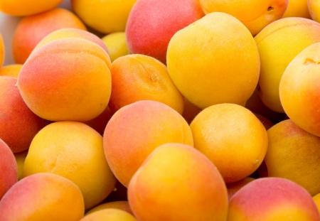 Fresh natürlichen Aprikosen-Hintergrund Standard-Bild - 5556487
