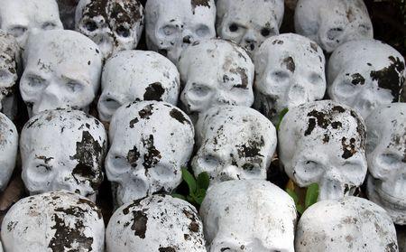 A pile of stone skulls background photo