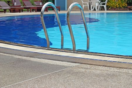 Fragment of pool with a ladder and water