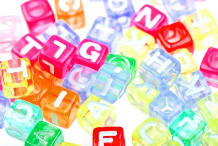 Abstract colourful alphabet blocks to background photo