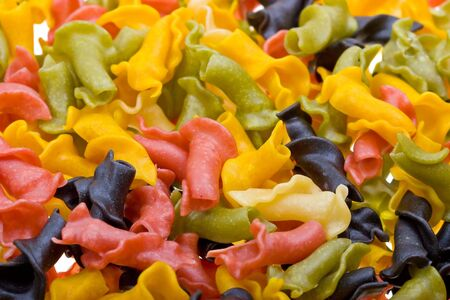 Close-up colored pasta to background photo