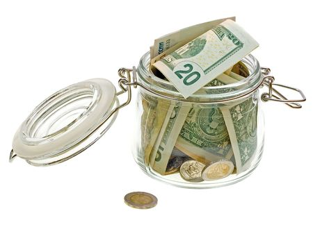 Different money in the glass jar isolated on white background   photo