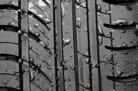 Close-up of car tire with with water drops to background photo