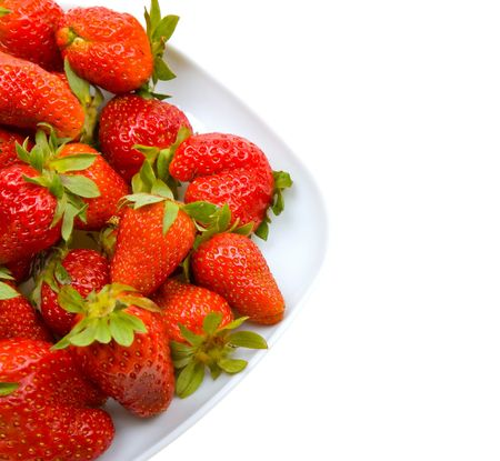 Fresh strawberries on a platter isolated on white background photo