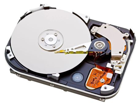 Close-up inside view of  hard disk isolated on white background Stock Photo - 6564323