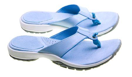 Blue women flip-flops isolated on white background photo