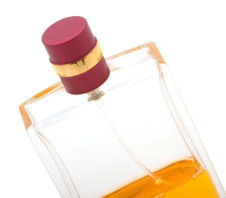 Yellow perfume bottle isolated on white background photo