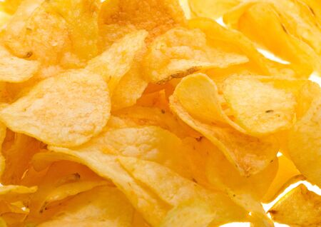 Close-up potato chips to background photo