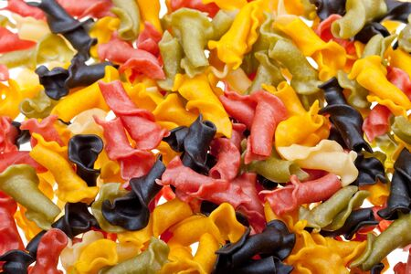 Close-up colored pasta to background Stock Photo