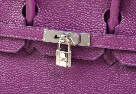 Close-up purple leather handbag with silver pandlock