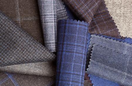 Zestaw kolorowe tkaniny we?nianej tkaniny tle