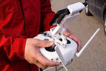 remote controls: Man use remote control that controls drone