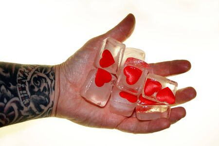 hand and frozen hearts photo
