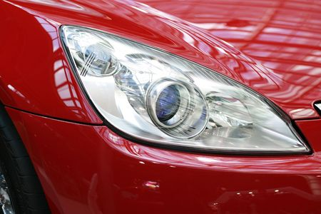 gleaming: Headlight on a new sports car