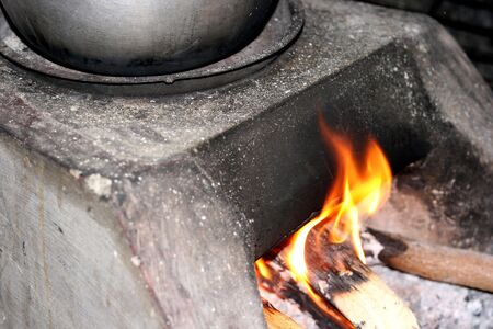 environment friendly: Cooking with firewoods - environment friendly lifestyle