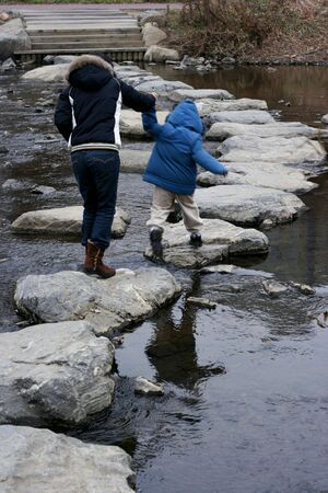 rock creek: Mother and child Crossing the River