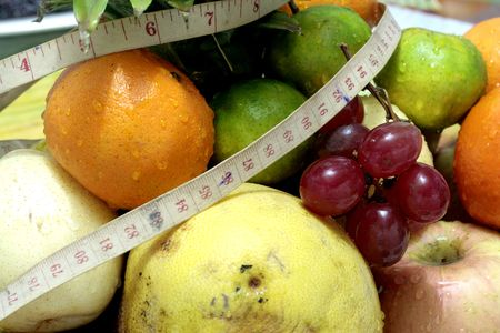 Tropical Fruits and Measuring Tape  photo