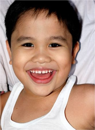 Close up portrait of smiling young boy Stock Photo - 2404542