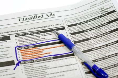 applied: newspaper opened to the want ads  highlighting the applied position