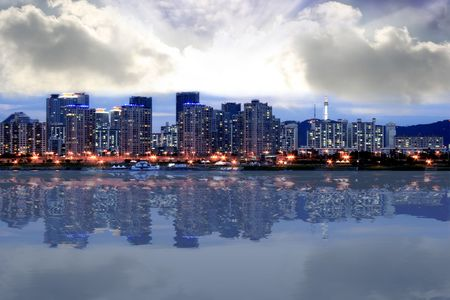 Seoul Skyline at Dusk with clouds still shining at low and high clouds Stock Photo