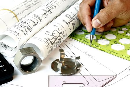 technical department: Draftsman with engineering plans and mechanical parts Stock Photo