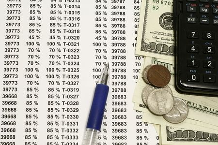 financial figures and percentages with currency and coins Stock Photo - 3351670