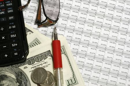 spreadsheet with percentages calculator, banknotes and pen on top note material is original by author Stock Photo - 3351672