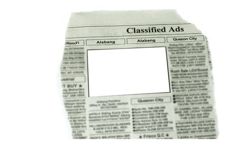 copyrights: looking for something in newspaper  note blurred all copyrights material