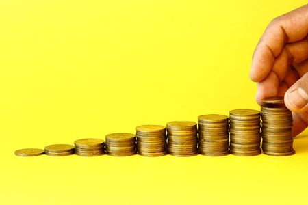 value add: Gold coins stack  Stock Photo