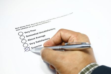 Filling out a customer service product survey form. Stock Photo - 3764286