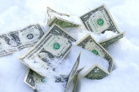 Dollar bills on the snow concept for frozen accounts Stock Photo - 4229862