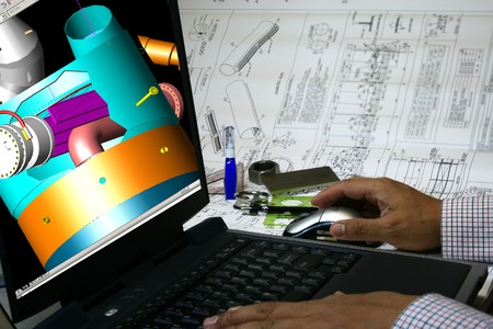 Mechanical engineer designing a pressure vessel. Note 3d display in the monitor is my original works. photo