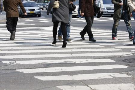 cross leg: Street crosswalkers  Stock Photo