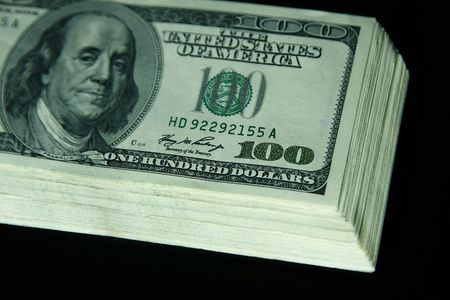 Close up of the 100 bills in black background Stock Photo - 5260518