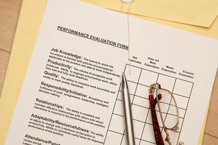 this is a close up image of an employee performance evaluation form photo