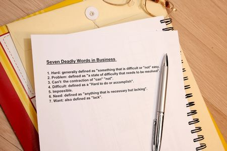 manila envelop: 7 deadly words in business concept - use in company workshops or seminars. Stock Photo