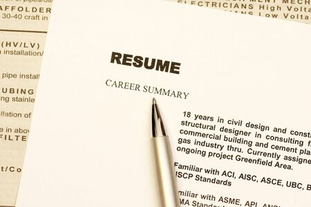 Resume curriculum vitae with newspaper ads as background photo