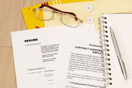 secretarial: I Fond a job concept with his resume on his employment contract. All data is fiction.