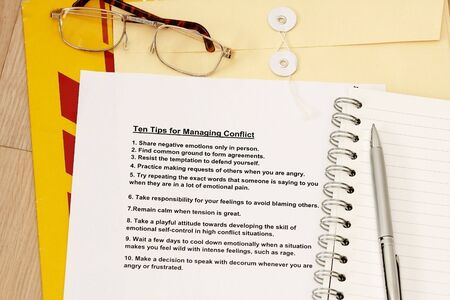 manila envelop: Ten tips for managing conflicts concept - many uses for training, seminar and company workshop. Stock Photo