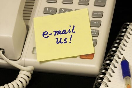 Voip Phone with email us message written on yellow note. Stock Photo - 5794012