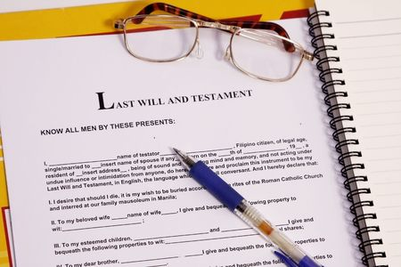 last will and testament form with notebook and pen. photo